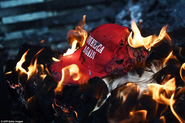 burning MAGA hat