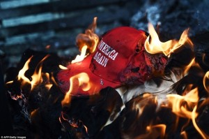 burning-MAGA-hat-300×199