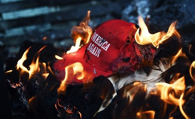 burning-MAGA-hat-624×381